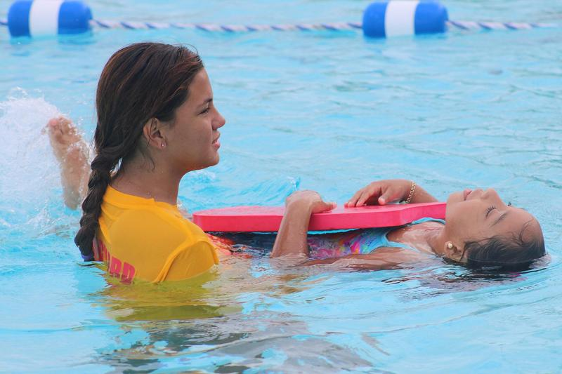 Pictured are Mission Aquatic Center Lifeguard with a Learn-to-Swim student.