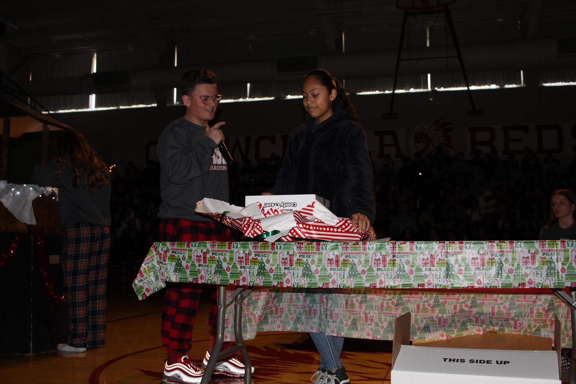 Yazmin Gonzales opening her gift
