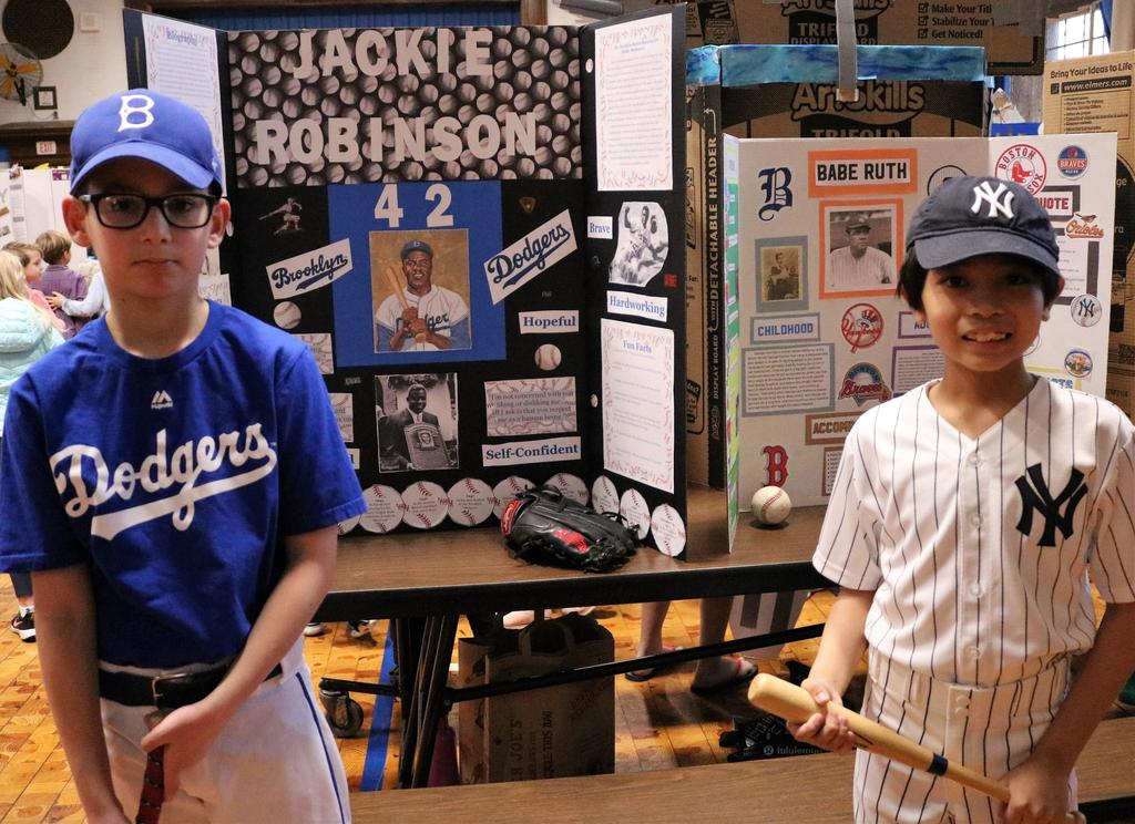 "Photo of two Wilson 5th graders as Jackie Robinson and Babe Ruth at annual ""Wax Museum"" event."