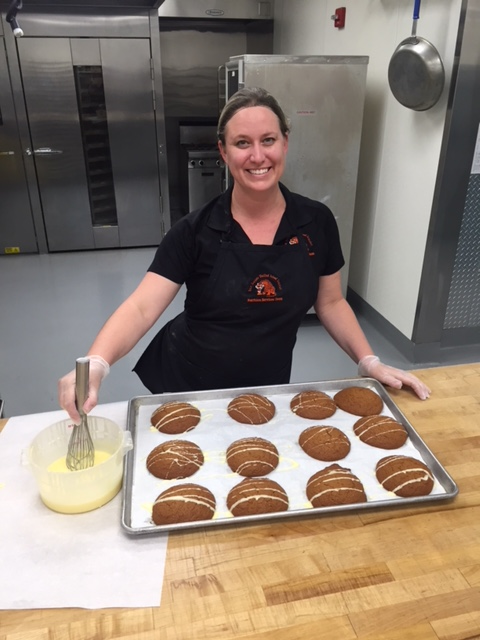 Bakery Lead Production Assistant Sarah Stack makes final sweet touches to the new Sunshine Scones made from local ingredients.