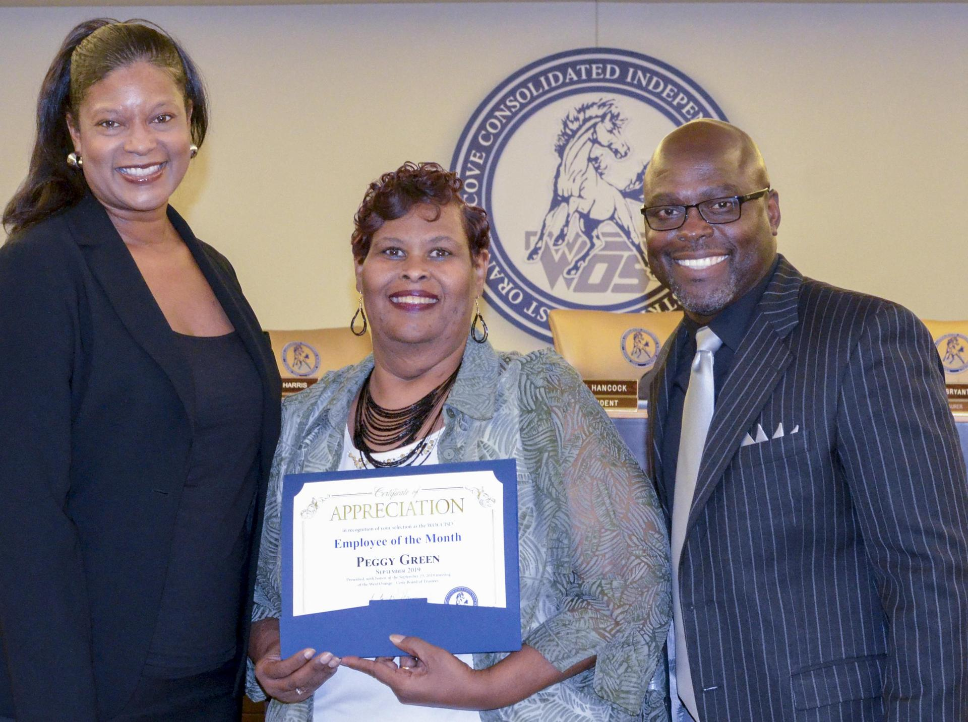 Peggy Green, September's Employee of the Month. Pictured with WOS High School Principal Ms. Rolanda Holifield and Superintendent Dr. Rickie Harris.