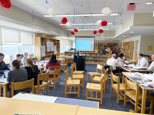 EPS administrators at desks inside a library