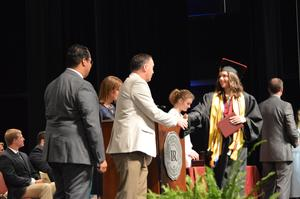 Katie Ezell shakes Dr. Gabriel's hands after receiving her diploma