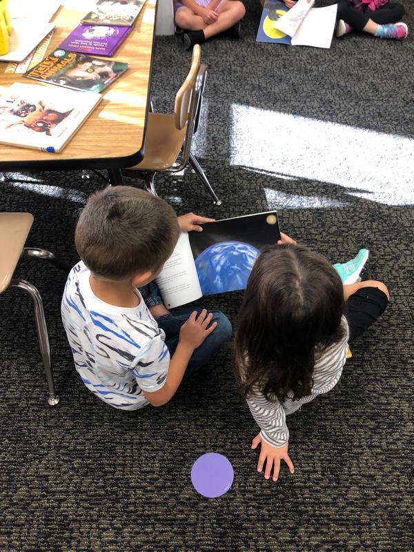 Kindergarten celebrating reading together!