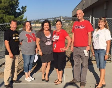 Principal, Mrs. Robilotta, and staff wearing College T-Shirts