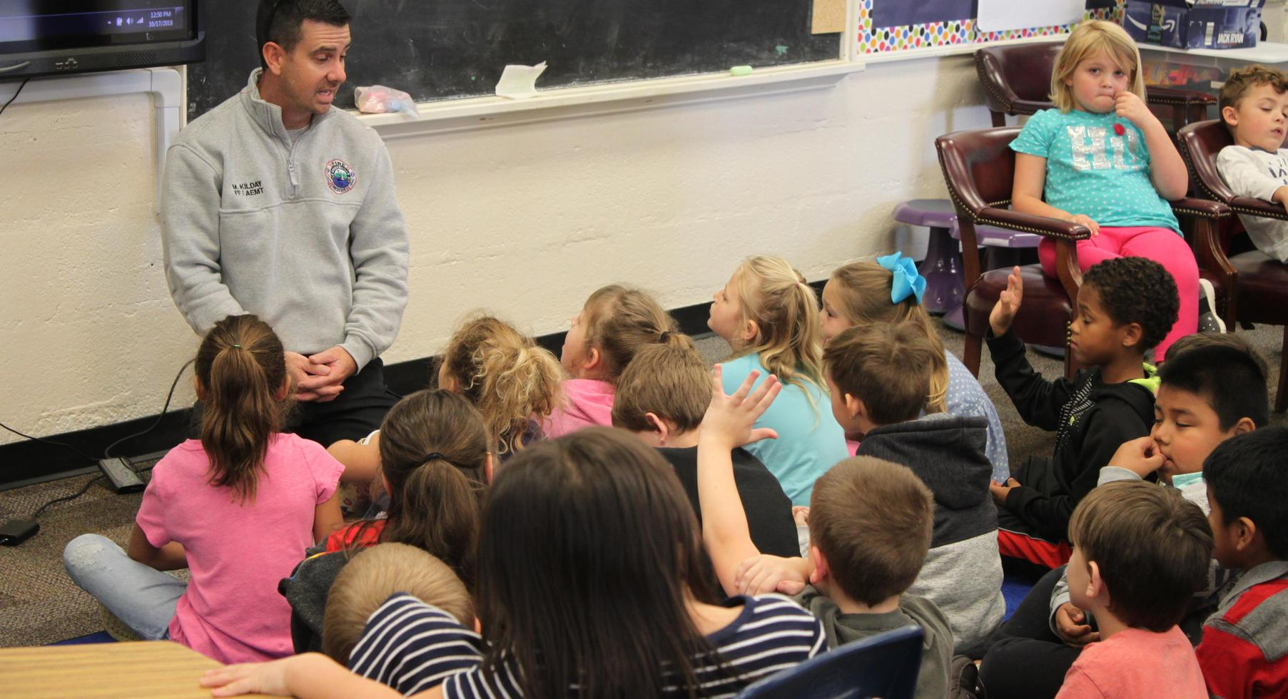 First Grade learns about fire safety from a Greeneville fireman.