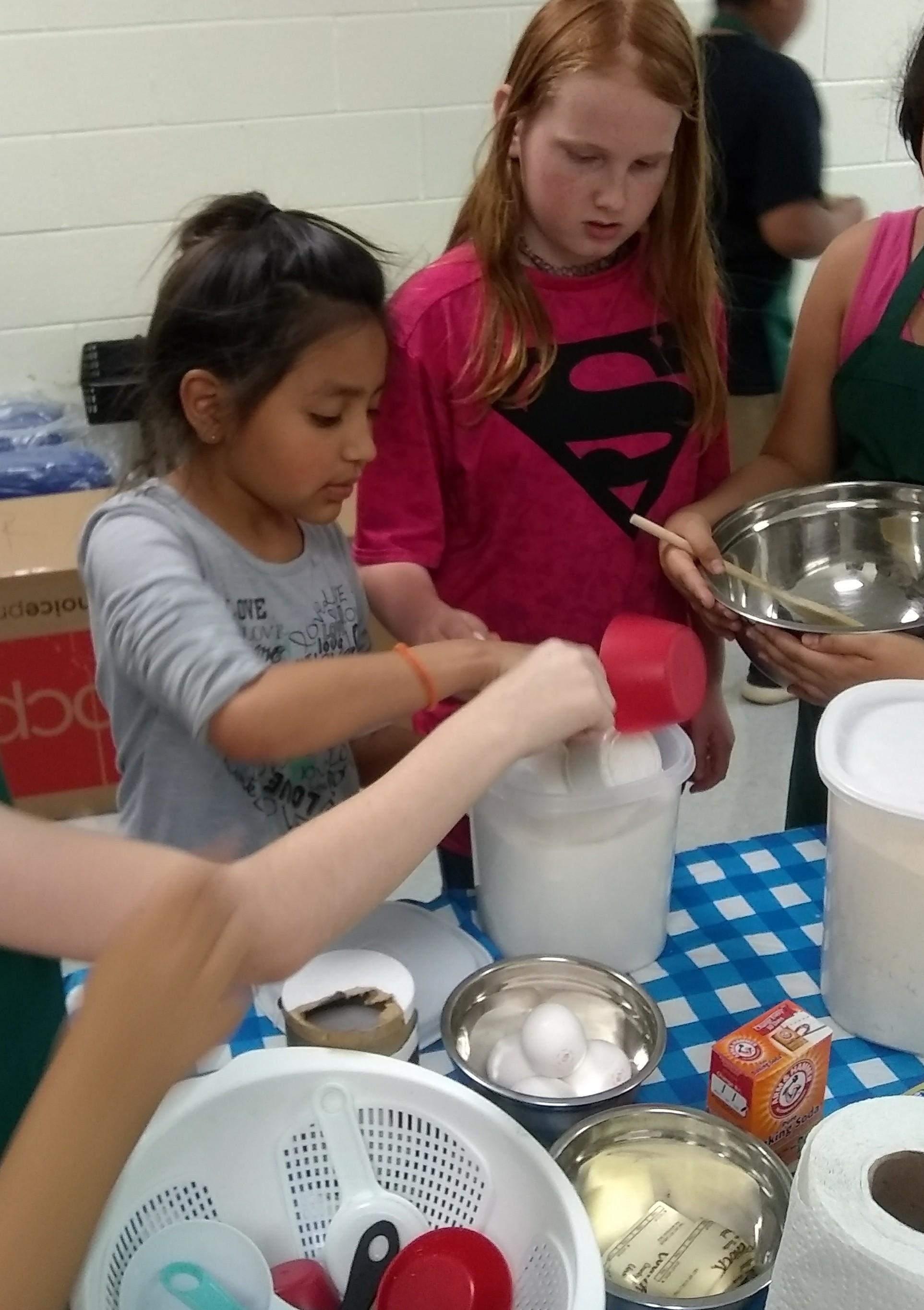 kids preparing banana bread together