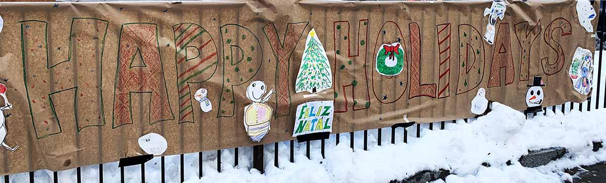 A long 'Happy Holidays' sign made by students