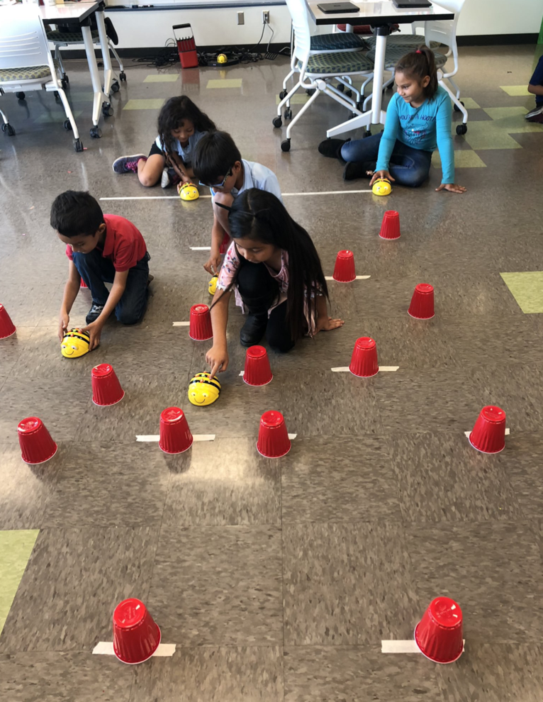 Students learning to code their Bee Bots!