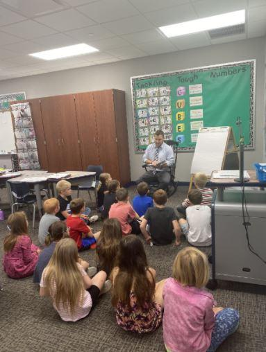 Mr. Hoard reading a story