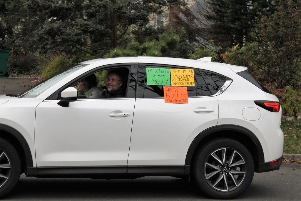 Photo of Washington teacher participating in a car parade for students during COVID-19 distance learning.