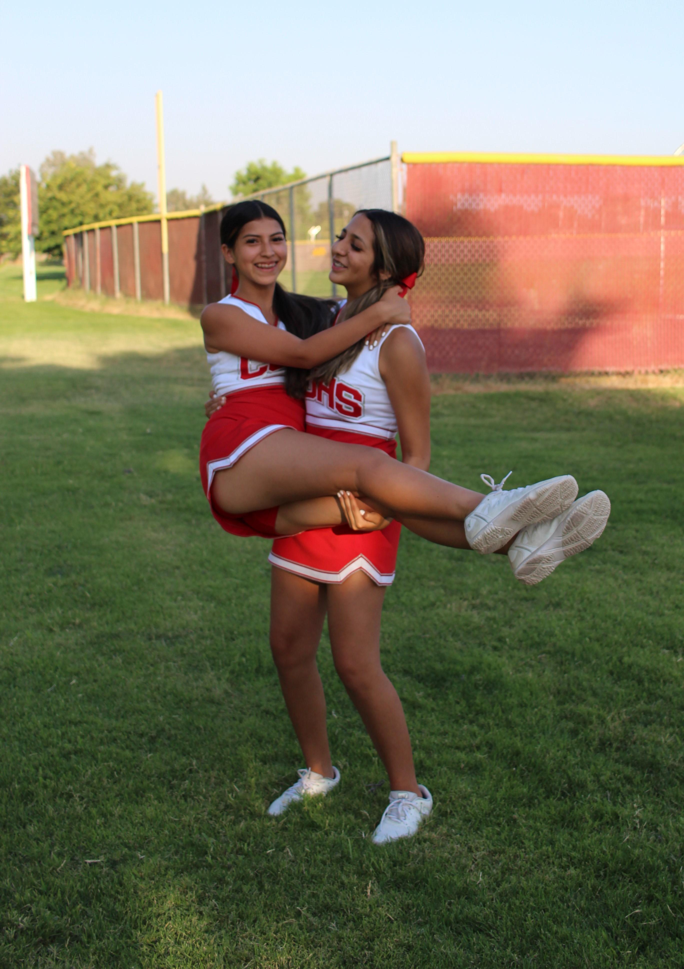 Cheerleaders cheerleading at the football game against Golden Valley