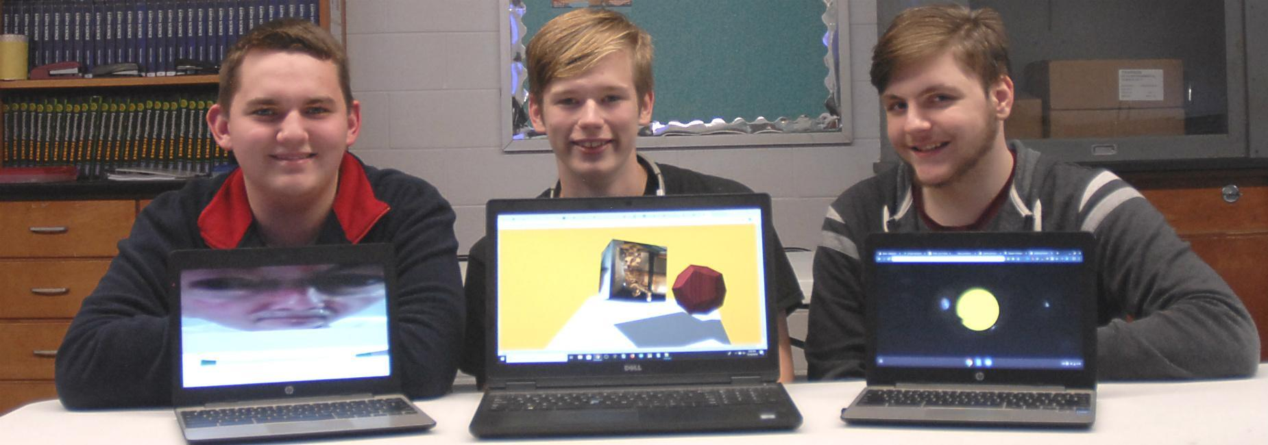 Three students displaying the 3D images they created for Advanced Placement Computer Science Principles class
