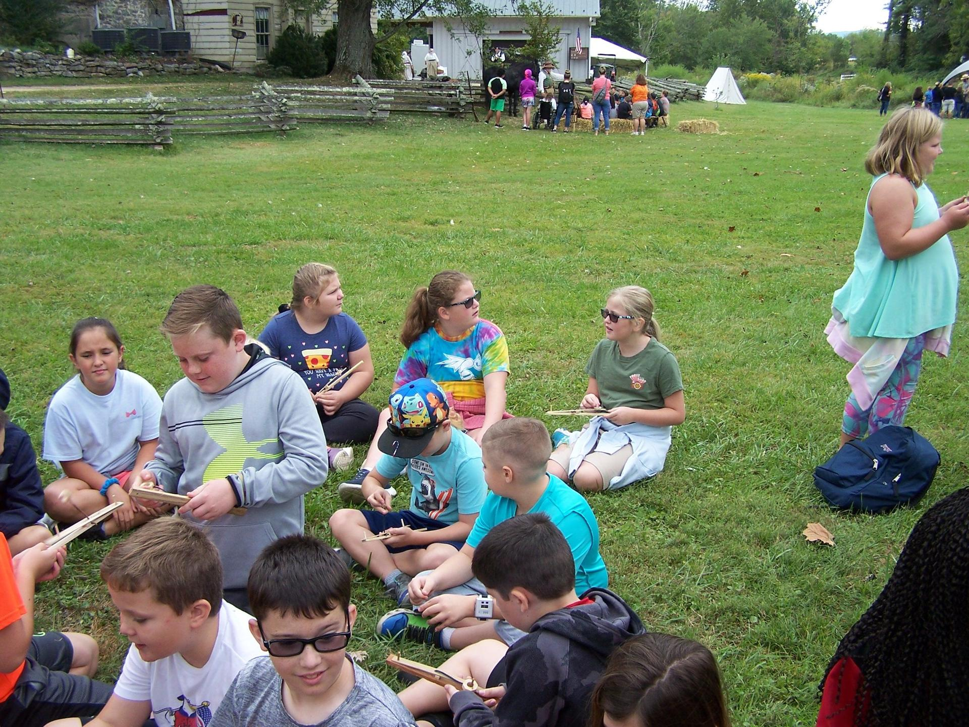 Students at Mustering Grounds in Abingdon learning about Revolutionary War games
