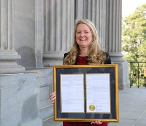 Beth Branham with resolution at SC State House (Photo courtesy of SCSBA)