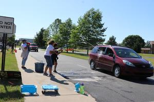 specials teachers at WSE get cars with super soakers