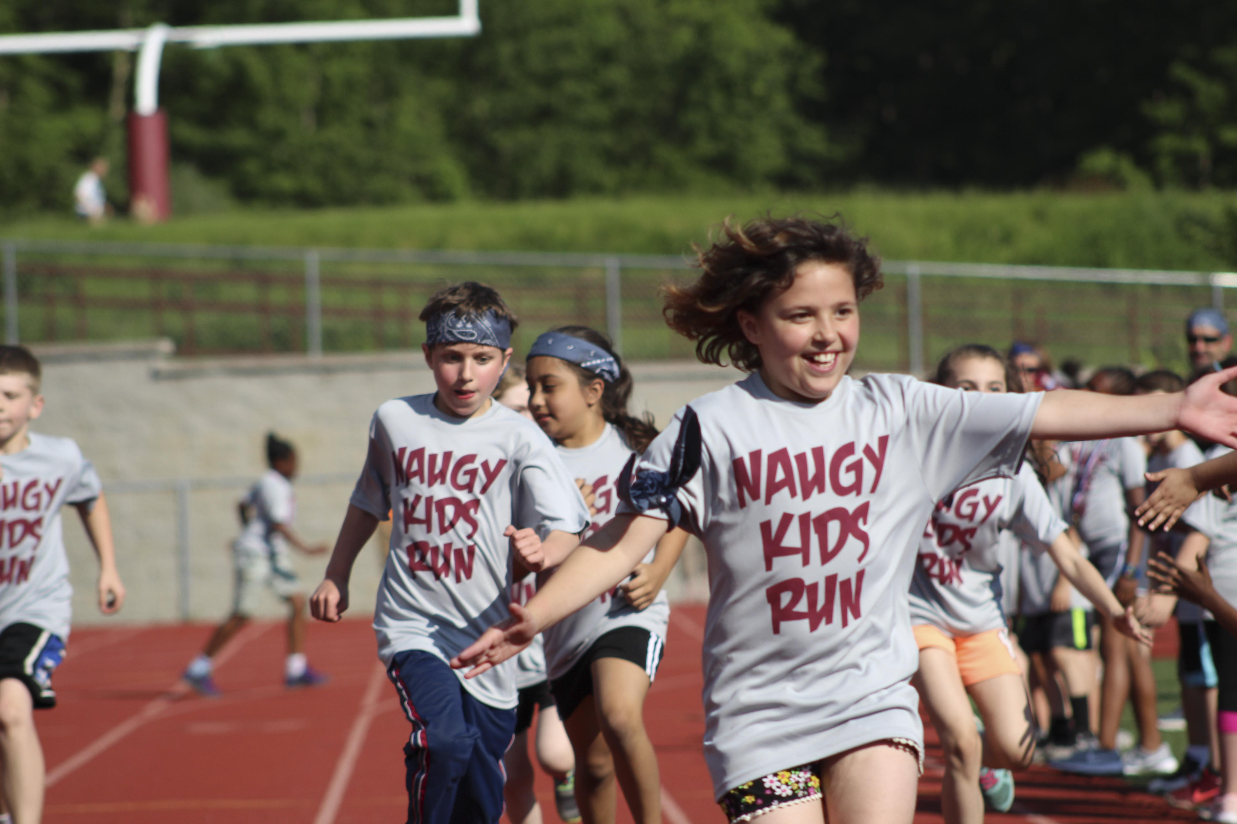 Naugy Kids Run - students running on track