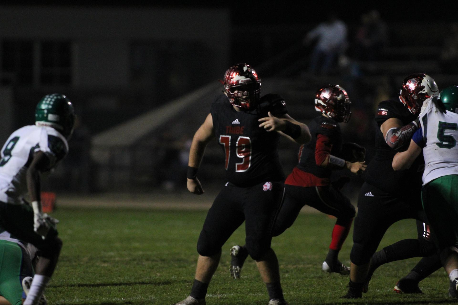 Football players in action against Highland