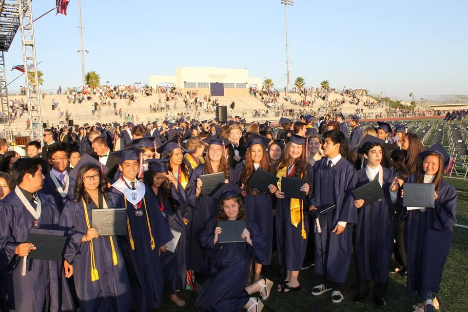 A group of graduates posing together
