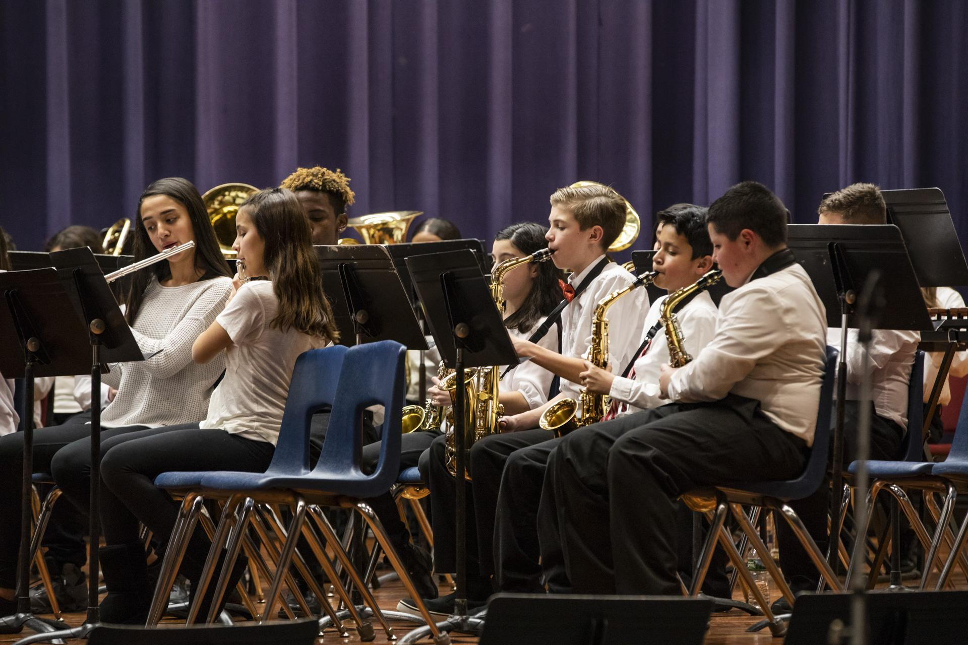 CHMS students playing instruments at concert