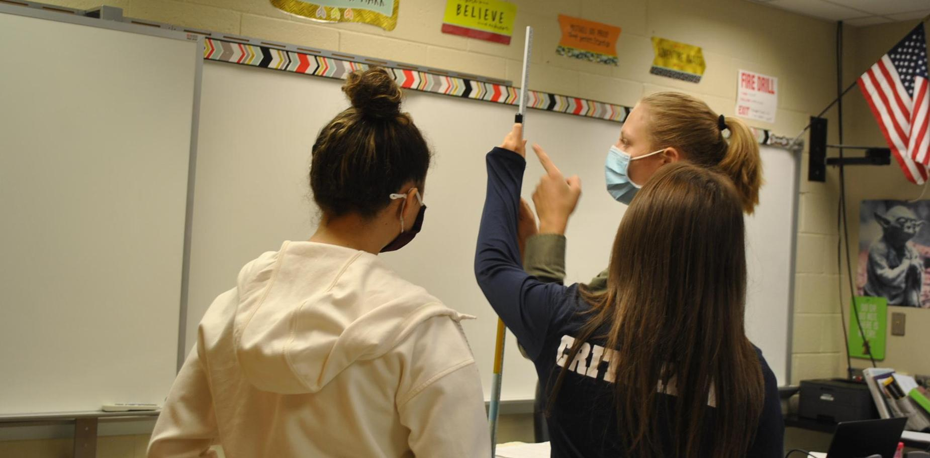 Physics students completing a lab