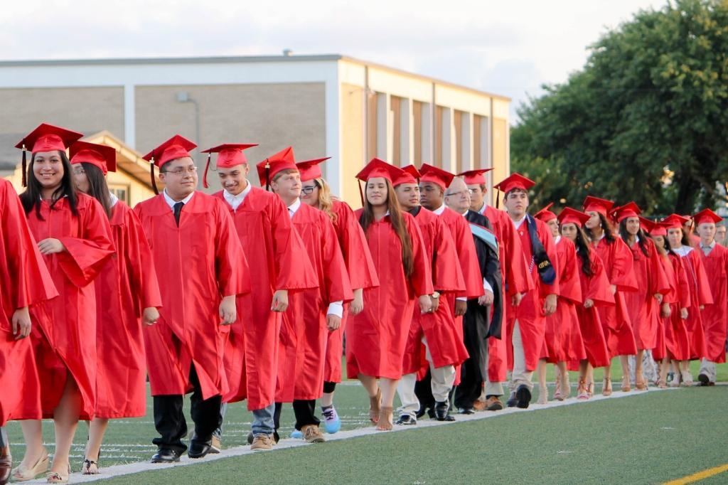 students of the victoria east high school 2018 graduating walking into memorial stadium