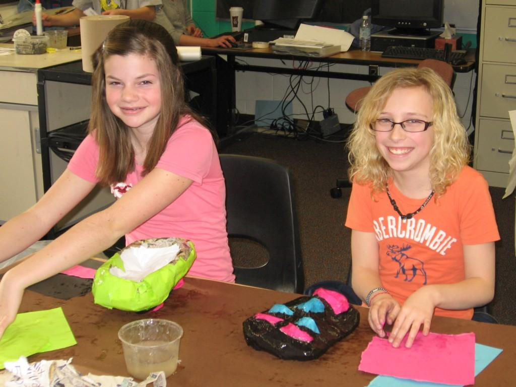 girls create crafts with colored paper