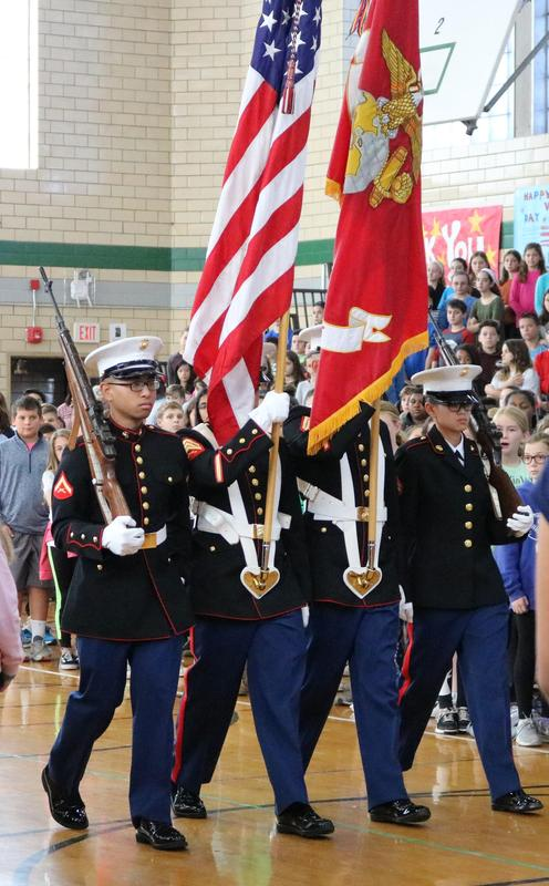 Members of the Combat Logistics Batallion 25, 4th Marine Logistics Group present the colors during Edison Intermediate School's annual Veterans Day assembly on Nov. 7.