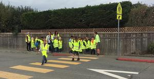 class practicing crossing the street