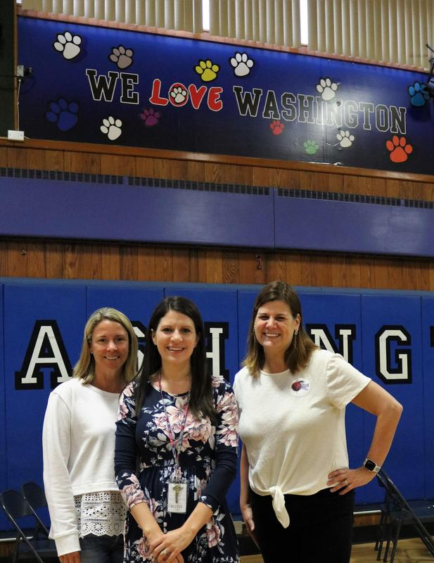 Washington School art teacher Diana D'Amico (center) thanks PTO Co-Presidents Wendy Nitche (left and Jennifer Moshier for their help with a creative and collaborative murals project that was unveiled on April 22 in the school's gymnasium.