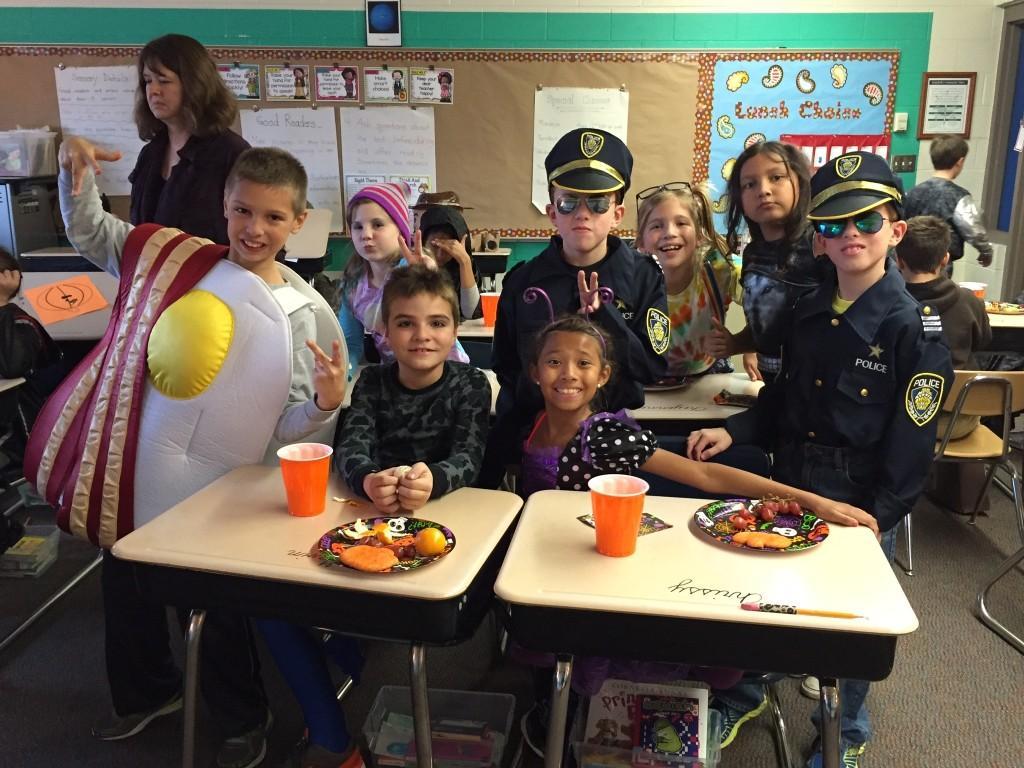 kids in costumes in class