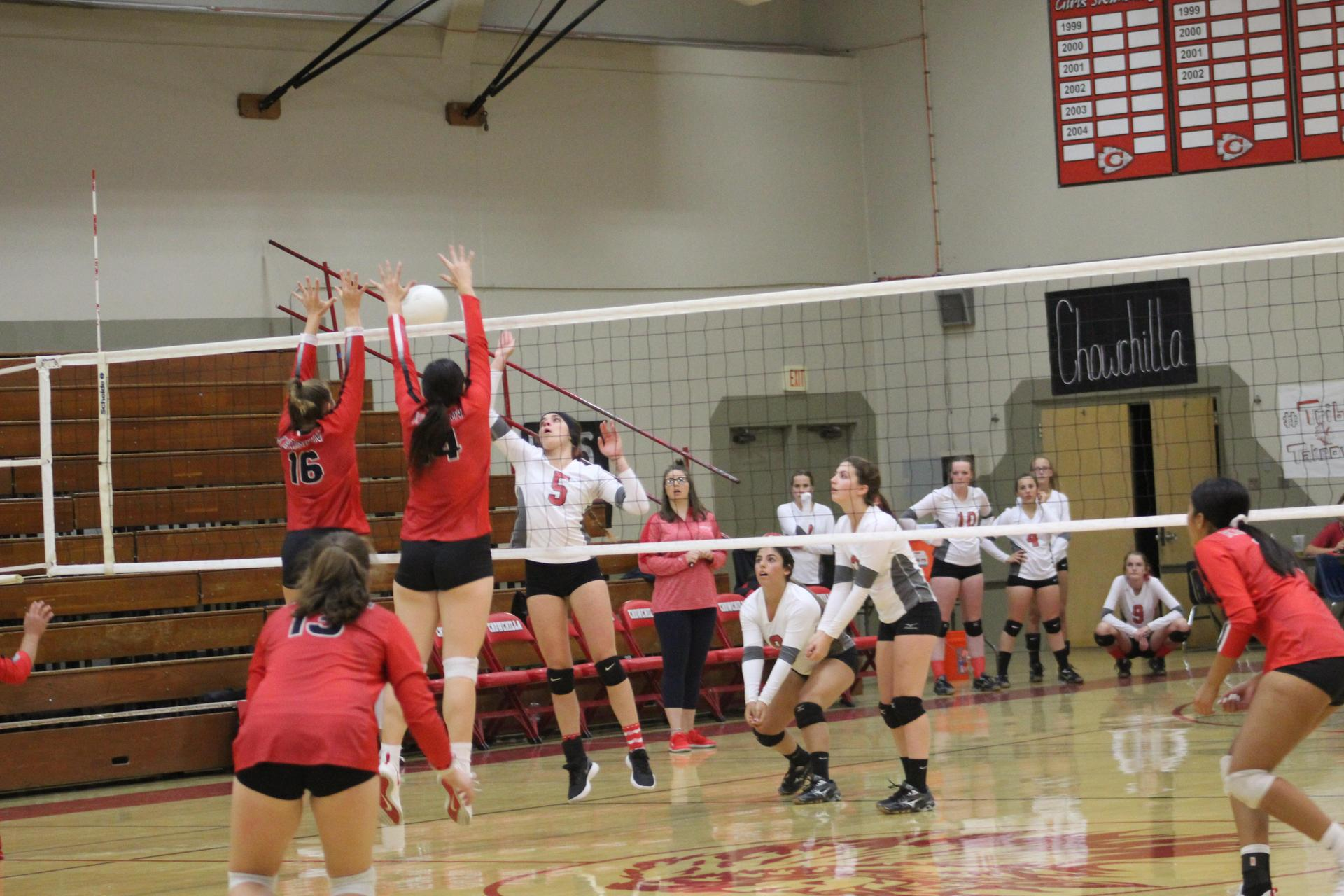 Varsity girls playing volleyball against Kerman