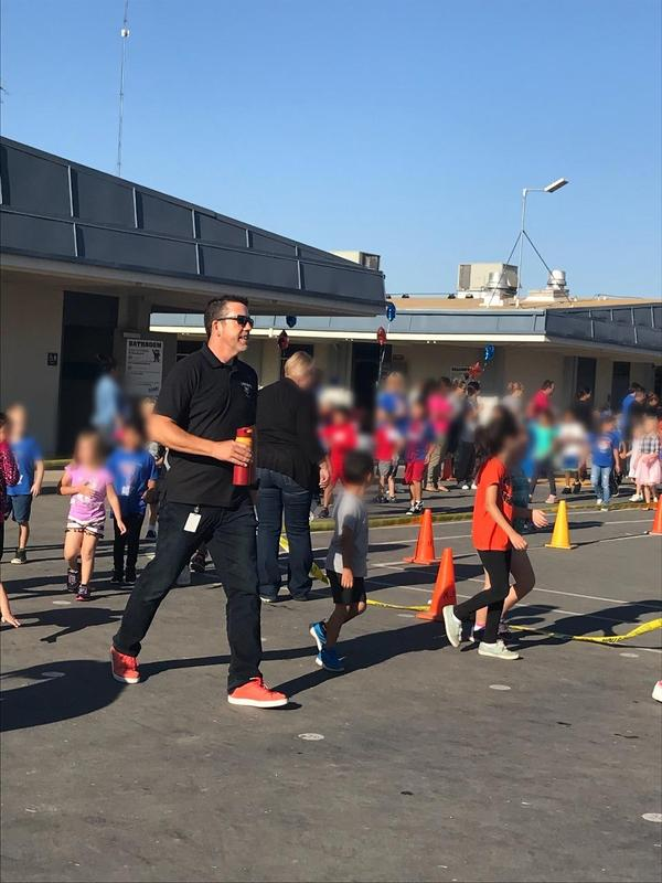 School Principal walking with students