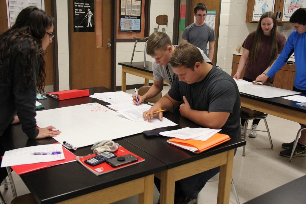 Students working on an assignment in a science classroom