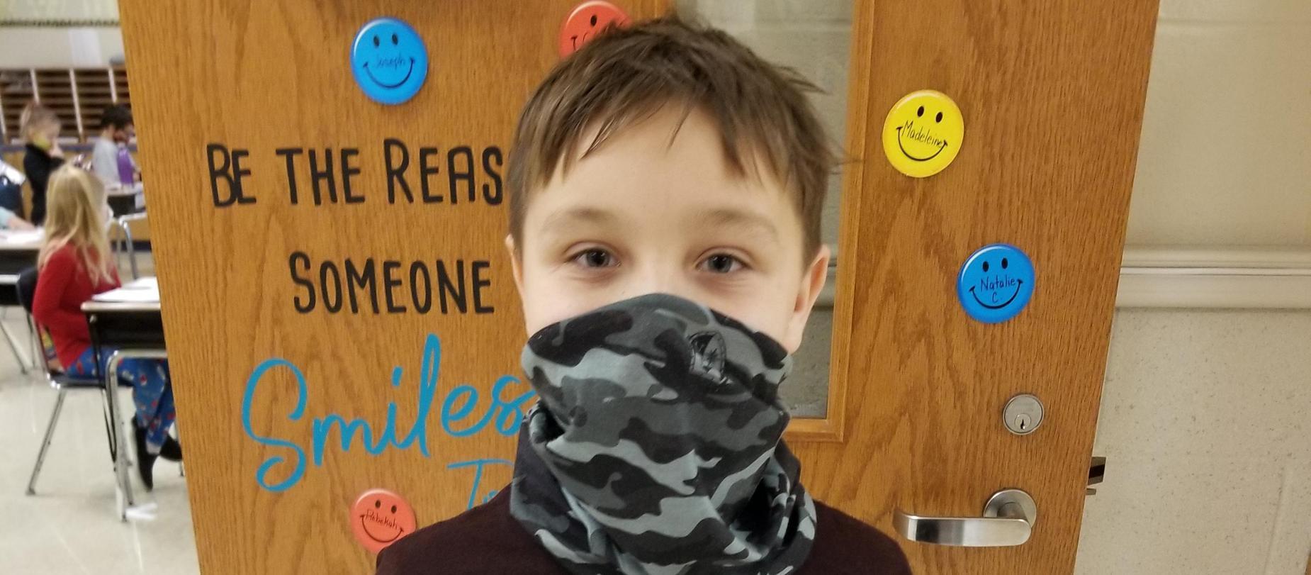 boy wearing a mask posing for camera