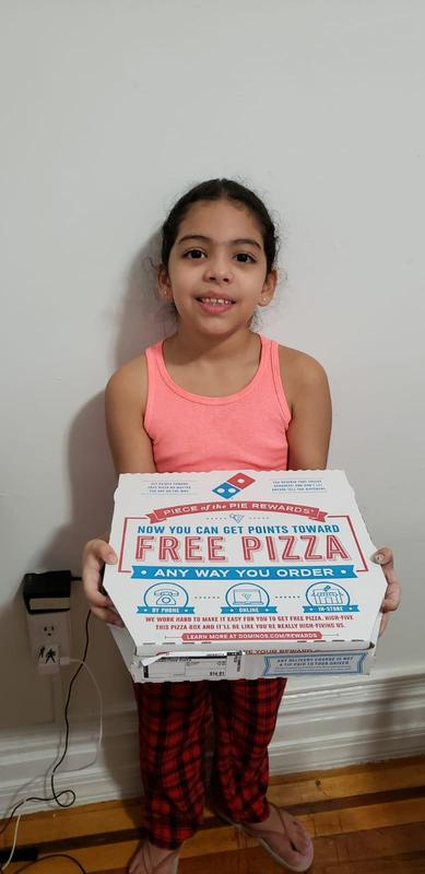 Sofia with her pizza