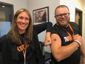 TK administrators show they are TK Strong with the temporary tattoos.
