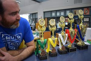 Adam Lane and trophies from the Science Olympiad Invitational