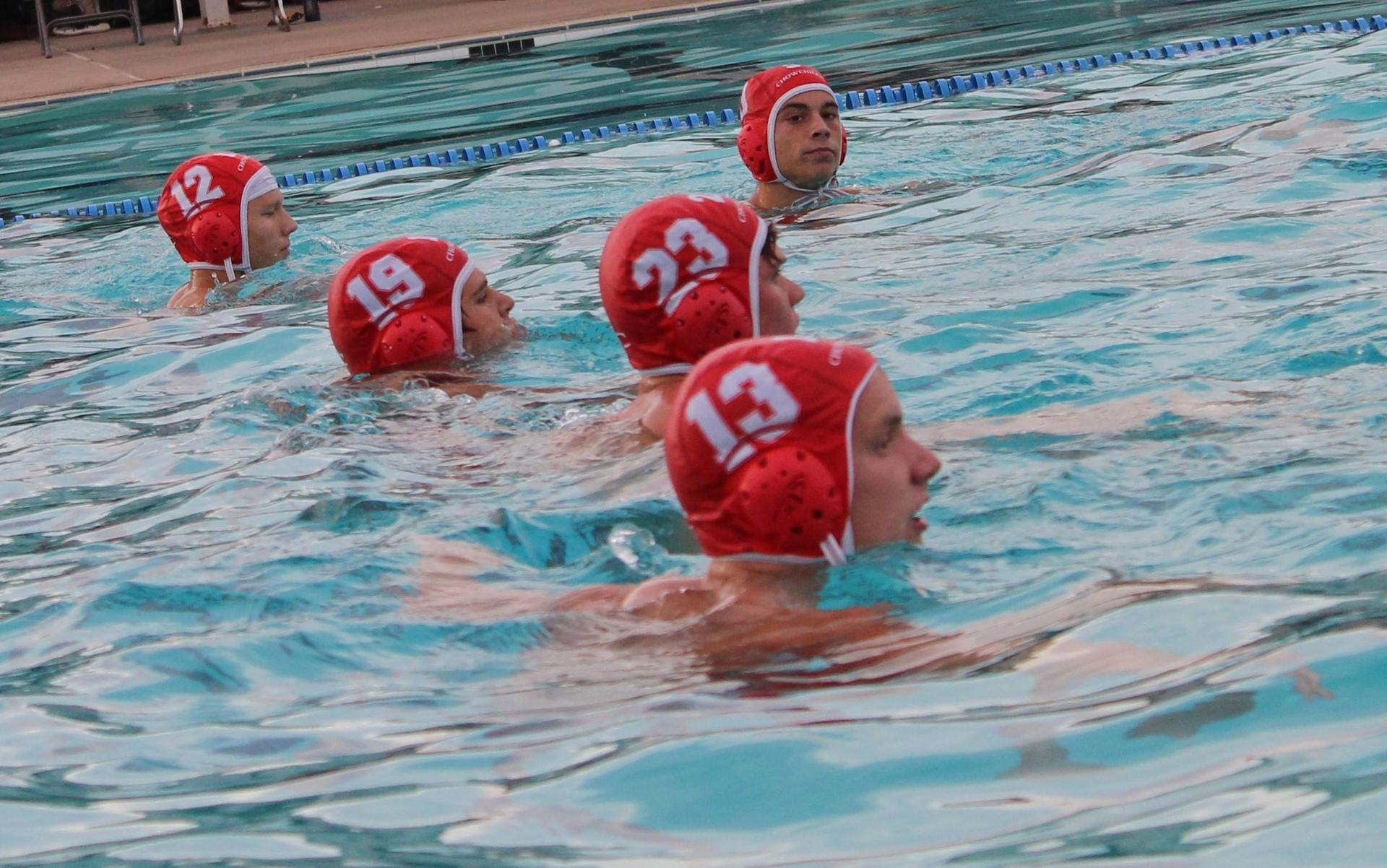 Boys playing water polo against Yosemite.