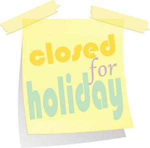 Yellow paper saying Closed for Holiday