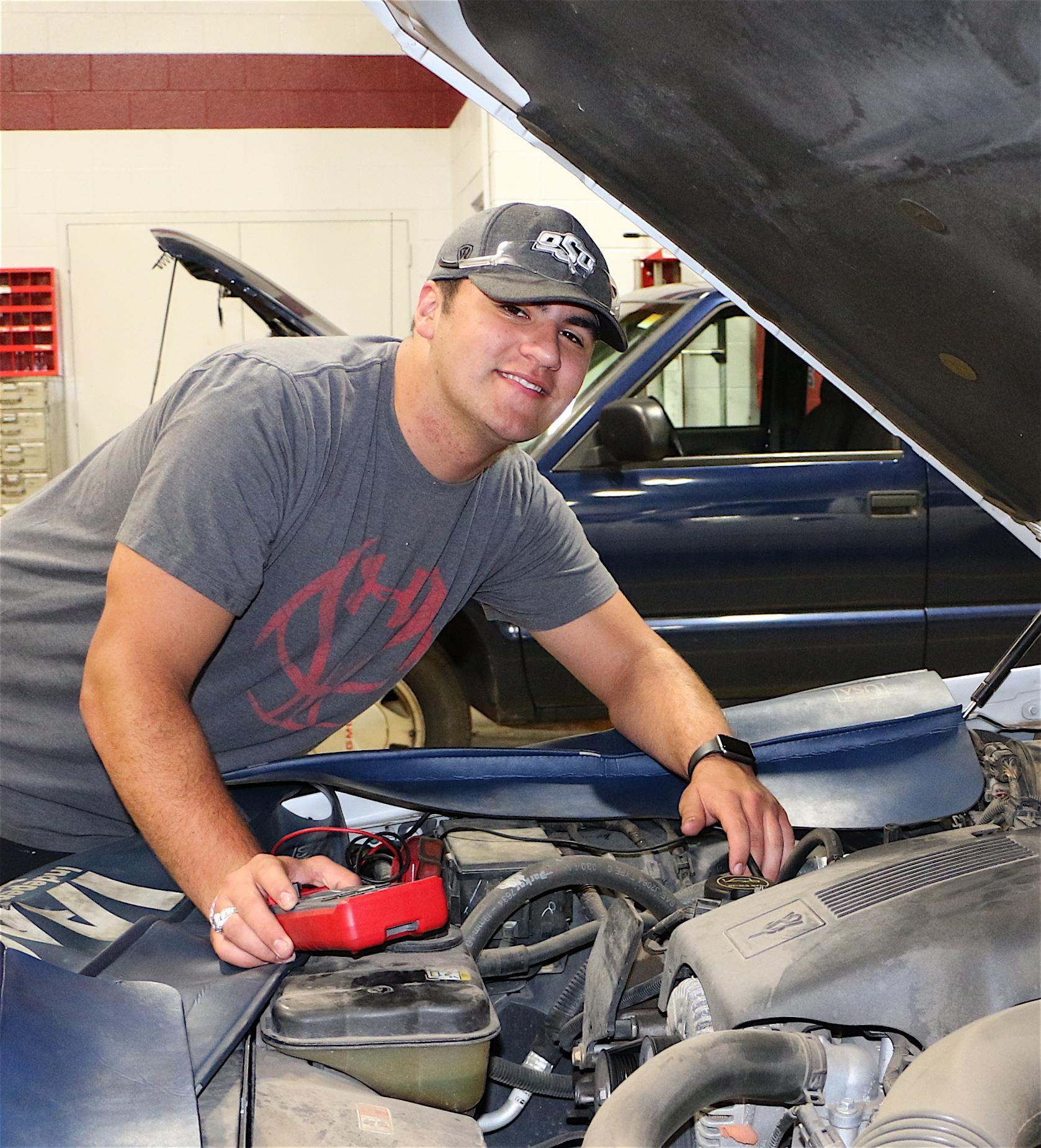 student working on car