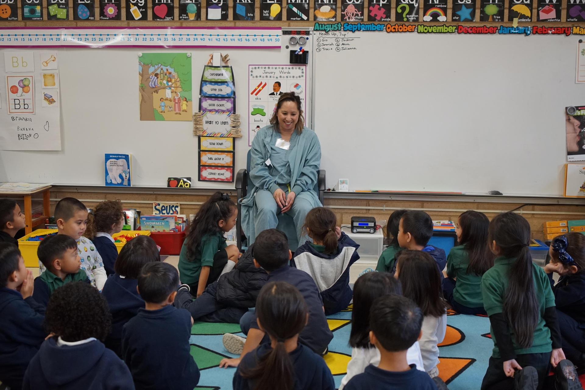 Dianne Sanchez from the class of 1996 speaks to TK/Kindergarteners about her career as a nurse.