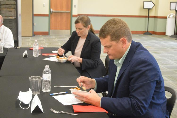 Ryan Moore and Suzanne Tilghman, judges in a GICCA culinary competition Tuesday, try one of the many dishes created by the students.