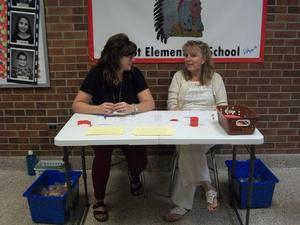 Sign-in table with Dr. Hall and Mrs. Sykes.