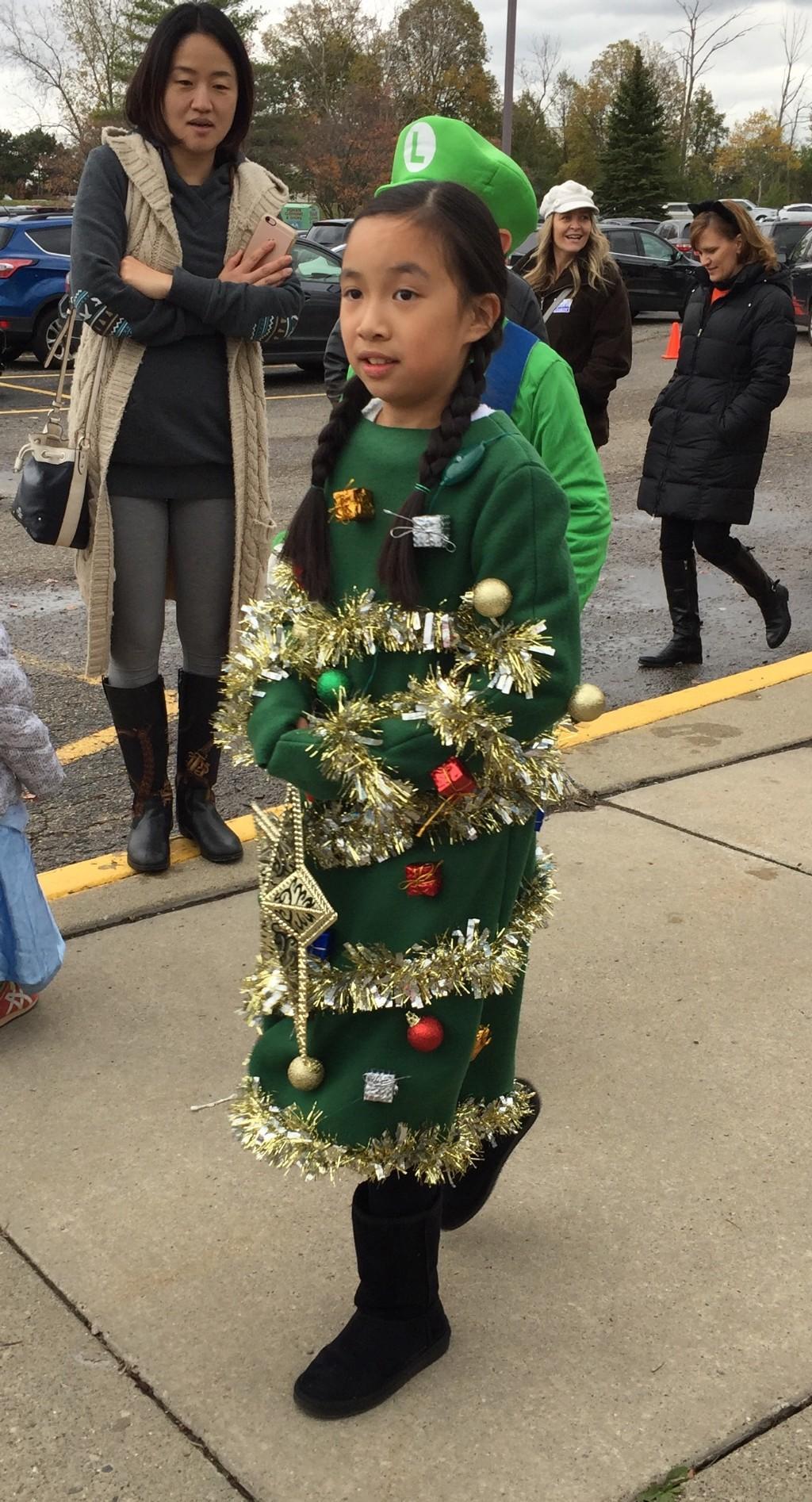 Halloween girl dressed as a Christmas Tree