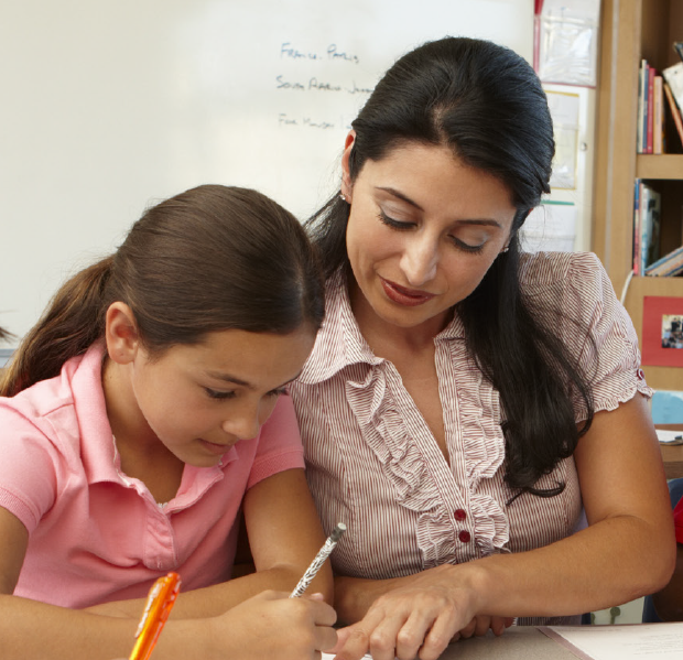 Teacher reading to a young student.