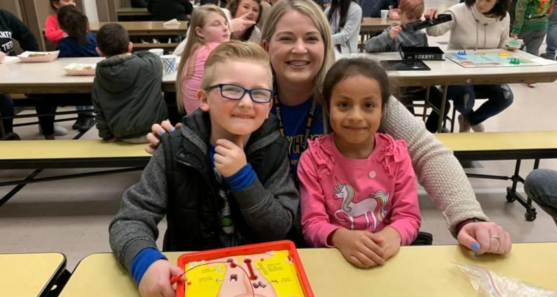 Teacher and two students enjoying Family Night at Rocky Heights.