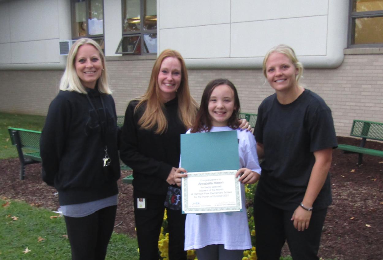 Annabelle Mason with her teachers