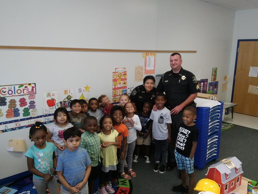 Pre-K students in group photo with law enforcement officers from Wilson PD
