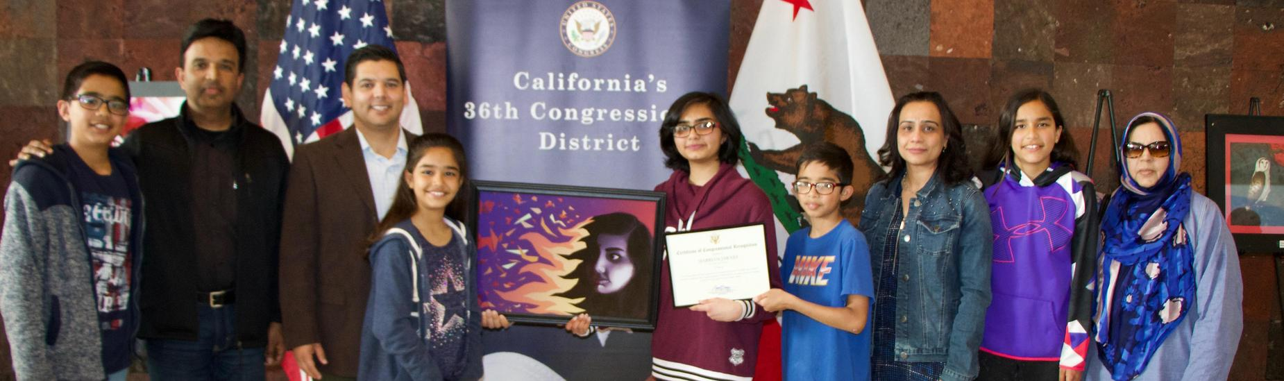 Student Wins Congressional Art Contest with Family and Congressman